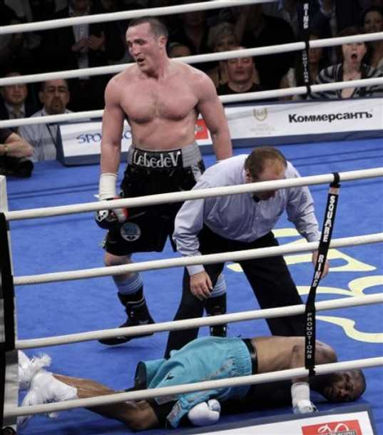 Russia's Denis Lebedev, top, seen just a moments after he knocked out Roy Jones Jr. bottom, during their fight at the Megasport Arena in Moscow, Russia, Saturday, May 21, 2011. Denis Lebedev knocked out Roy Jones Jr. in the last seconds of the final round of their cruiserweight fight in Moscow on Saturday. (AP Photo/Sergey Ponomarev)